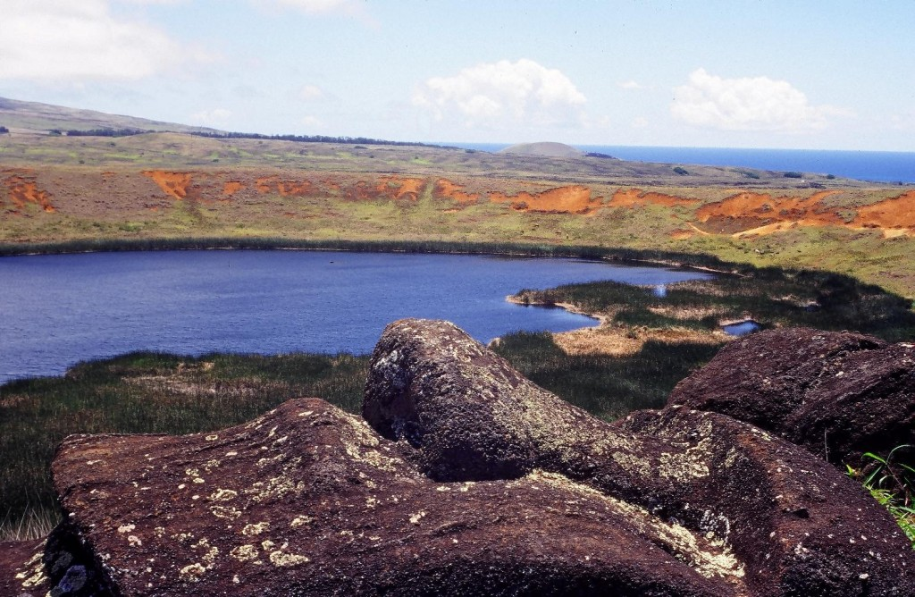 The crater of the Rano-Raraku volcano at Easter Island, seen from the summit of the ridge, contains a lake partly covered by floating islands of reeds.